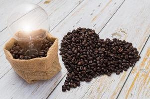 Love drinking coffee, coffee beans in a heart shape, light bulb emitting energy photo