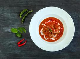 Authentic Thai red curry on a wooden background photo