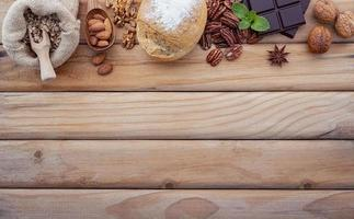 Ingredients for healthy food selection. Concept of healthy food set up on a shabby wooden background photo