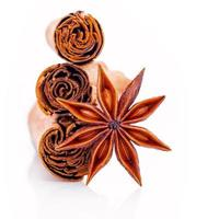Ceylon cinnamon sticks and anise star isolated on a white background photo