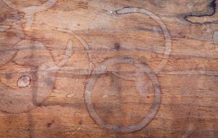 Coffee cup stain on shabby wooden background. Beverage background and coffee menu design