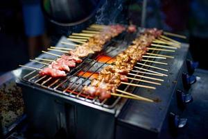 Traditional grilled pork and meat by gas system grill photo