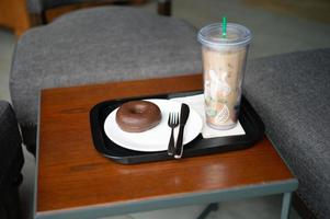 Chocolate doughnut served with a personnel glass of coffee photo