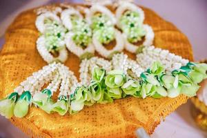 Closeup of floral garlands for bride and groom in traditional Thai wedding photo