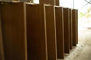 Selective focus on wooden laminated board at the factory waiting for installation