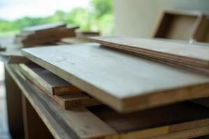 Selective focus on pile of wooden boards for installing the interior work at the construction site