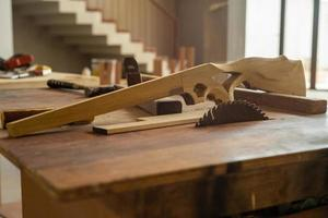 Selective focus on wooden gun shape at factory photo