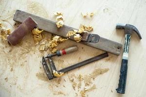 Top view of carpenter tools with sawdust