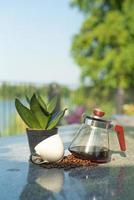 Portrait of a glass jar with coffee inside and empty cup on the table