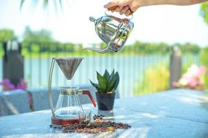 Hand pouring drip coffee photo