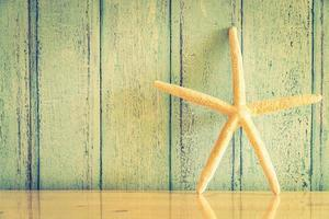 Starfish decoration on wood background photo
