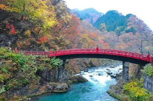 Landscape picture of Shinkyo Bridge with colorful leaves in autumn in Japan
