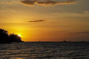 Silhouette of island and yacht boat photo