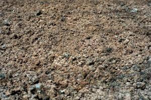 Fondo abstracto y textura del suelo con la sombra de la estructura de acero en el suelo en el sitio de construcción foto