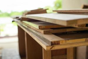 Selective focus on pile of wooden boards for installing photo