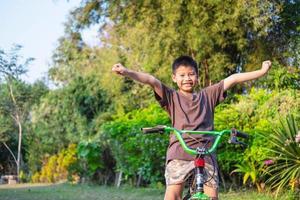 Boy on a bike outside