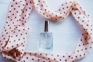 Perfume surrounded with a ribbon