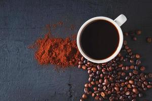 Top view of roasted coffee in a cup photo