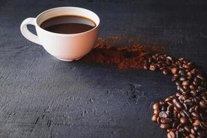 Cup of coffee with beans photo