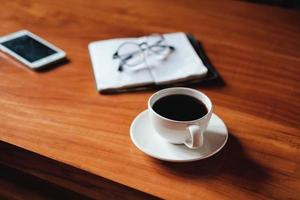 Coffee on a desk photo