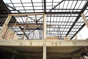 Steel structure for the roof of the house under construction. photo