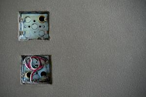 The zinc blocks of electrical outlet under installation photo