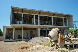Perspective and landscape of house under construction with blue sky in background photo