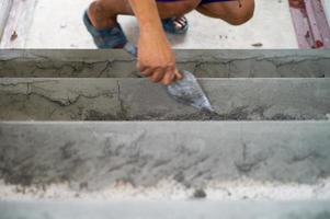 Selective focus on rough cement surface on the floor photo