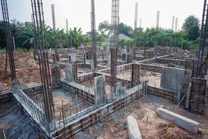 Landscape of house under construction site with reinforcement steelwork photo