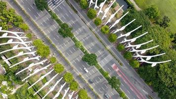 Jakarta, Indonesia 2021- Aerial view of highway in the morning and green trees photo