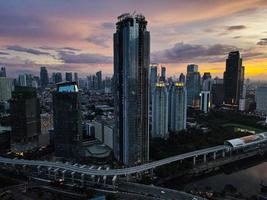 Jakarta, Indonesia 2021- Aerial view of sunset in the skyscrapers in the city of Jakarta photo