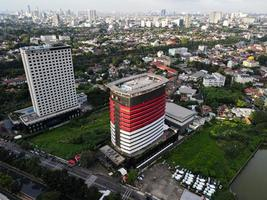 Jakarta, Indonesia 2021- Aerial view of highway intersection and buildings in the city of Jakarta photo