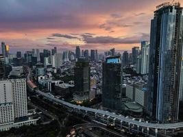 Jakarta, Indonesia 2021- Aerial view of sunset in the skyscrapers of Jakarta photo