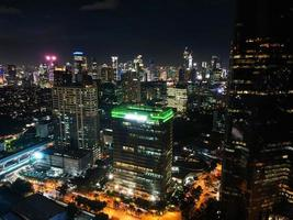 Jakarta, Indonesia 2021- Spectacular nighttime skyline of a big modern city at night photo