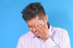 Man holding eye in pain photo