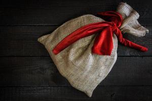 Christmas gift bag with red ribbon photo