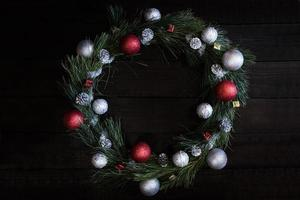 Christmas wreath of fir branches with Christmas decorations photo