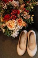 Bridal bouquet in red autumn shades dried flowers photo
