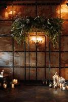 Wedding ceremony area with wood and rusty metal photo