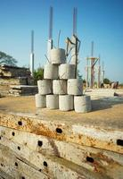 Cement lumps with wire for providing the space between wire mesh and ground