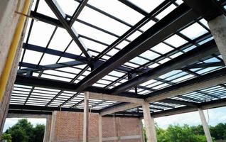 Steel structure for the roof of the house under construction photo