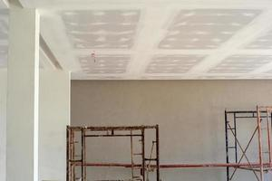 Plastered white cement applied on the ceiling board of a house under construction. photo