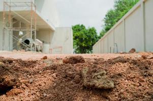 Fondo abstracto y textura del suelo en el suelo del sitio de construcción foto