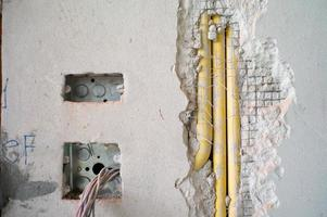 Abstract texture and background of electrical system under insulation inside concrete wall photo