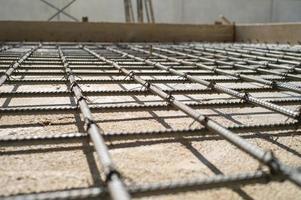 Closeup selective focus picture of steel line grid for reinforcement concrete structure photo