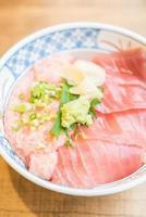 Raw fish tuna meat in rice bowl photo