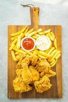 Fried chicken wings with french fries and tomato or ketchup and mayonnaise sauce