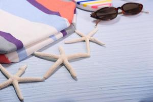 Summer beach accessories on table photo