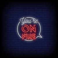 estás en llamas letreros de neón estilo vector de texto