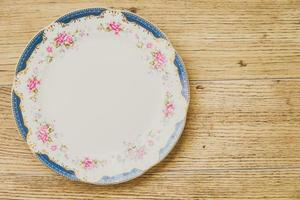 Vintage plate on wooden background photo